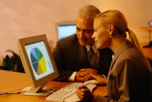 Businesspeople Working on a Computer Together