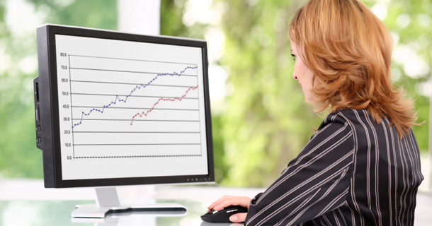 woman viewing chart on computer screen