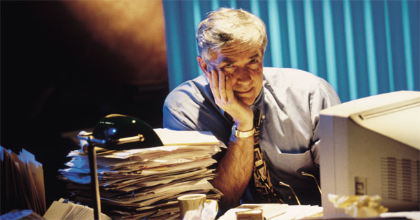 Overwhelmed Man at Desk