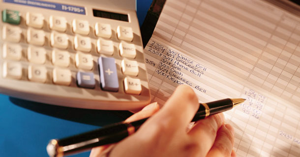 Calculator, pen and checkbook