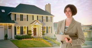 Woman with clipboard by decorated house