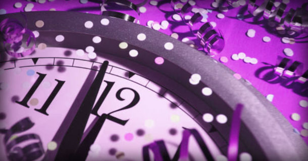 A Clock Striking Midnight and Confetti