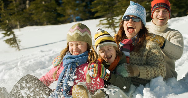 A Family sledding in the snow