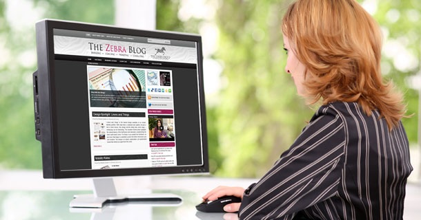 Woman looking at the Zebra Blog on a computer