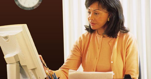 Woman writing at a computer
