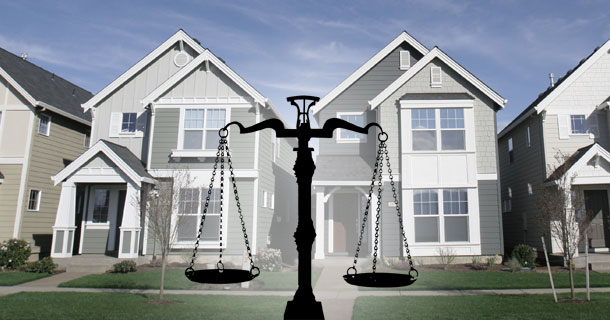 Scales of Justice in front of homes