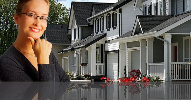 Female agent in front of houses