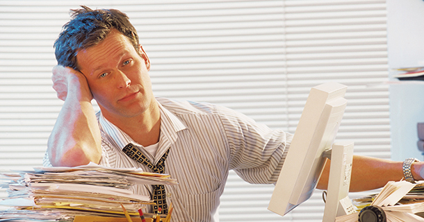 Man swamped in paperwork