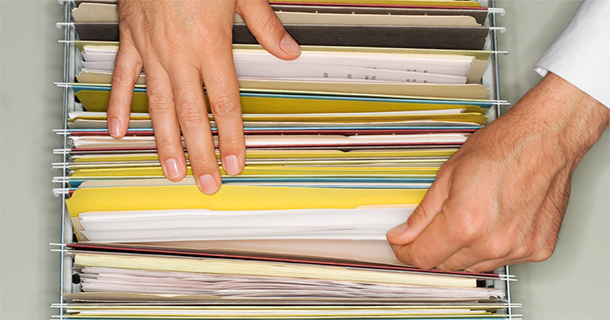 Man's hands and file folders