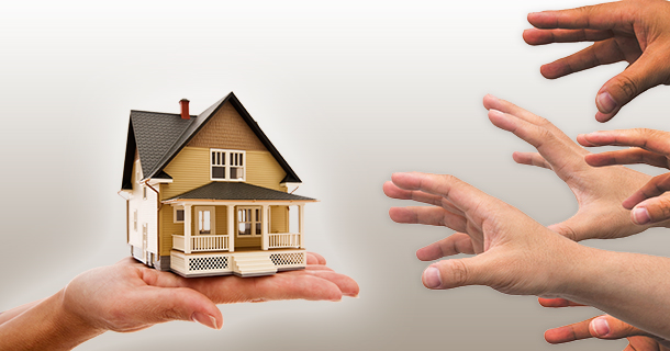 many hands reaching toward one house