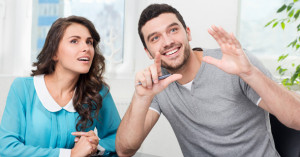 two people talking with hand guestures