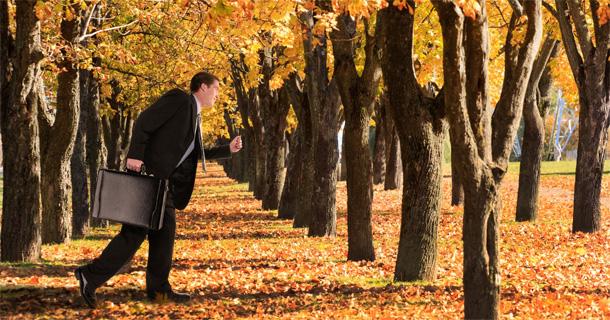 Man running thru autumn trees