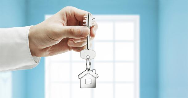 hand dangling house key