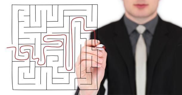 man drawing thru a maze