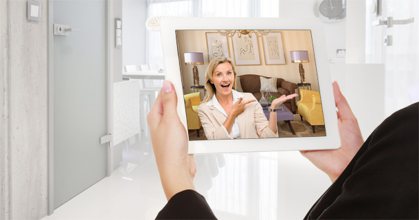woman holding tablet with video